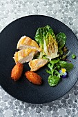 Crispy spring chicken breast with croquettes and cos lettuce