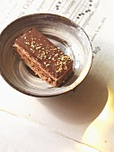 A slice of Opera Cake (almond cake with chocolate glaze, France)