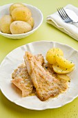 Ray fish with cumin and new potatoes