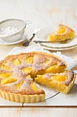 Peach and frangipani tart with powdered sugar