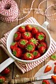 Fresh strawberries in an enamel colander