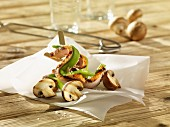 Grilled pork skewers with beans and mushrooms