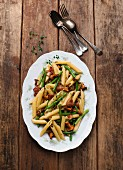 Pasta with green beans, bacon and chanterelle mushrooms
