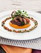 Grilled squid with chorizo on a bed of mashed sweet potatoes