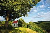 A chapel in a hilly landscape (Oberfanken, Germany)