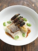 Sea bass fillet with asparagus and morel mushrooms