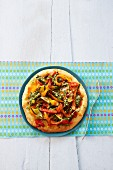 Vegetable pizza with peppers and pesto