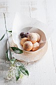 Ricotta dumplings with icing sugar and cherries