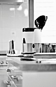 A juicer on a kitchen work surface