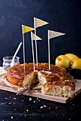 Lemon cake decorated with flags, sliced