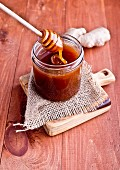 A jar of honey with a spoon