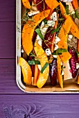 Oven roasted vegetables with pumpkins and beetroot on a baking tray (unbaked)