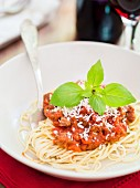 Spaghetti with vegetarian Bolognese, Parmesan cheese and basil