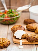 Falafel with a yoghurt and tahini sauce served with parsley salad