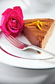 A slice of chocolate orange cheesecake