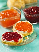 Scones with clotted cream, strawberry, and apricot jam