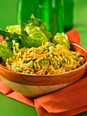 A bowl of broccoli and carrot curry with cashew nuts