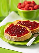Slices of white bread with raspberry and plum jam
