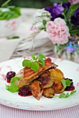 Roast pheasant with bacon, blackberry sauce and pea leaves