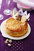 Puff pastry chocolate cake decorated with a crown (France)
