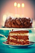 Slice of chocolate cake with grated chocolate and icing sugar