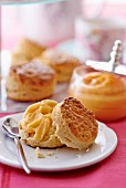 Scones with lemon curd on a plate