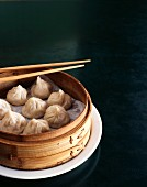 Pork dumplings in a steamer basket