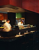 Japanese sushi chefs working in a kitchen