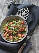 Quinoa salad with cucumber, tomato and coriander