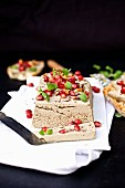 Goose liver terrine with pomegranate seeds
