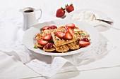 Heart-shaped waffles, fresh strawberries and cream