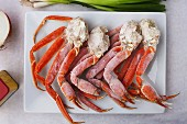 Frozen king crab legs on a platter (seen from above)