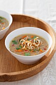 Red lentil soup with fried onion rings