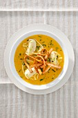 Carrot and pepper soup with tortellini