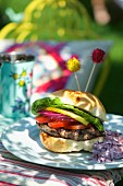 A hamburger and red cabbage coleslaw at a summer party