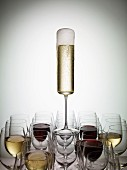 A glass of champagne balanced on wine glasses