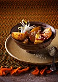 Potatoes with sesame seed and bean sprouts