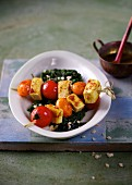 Tomato and tofu skewers with spinach