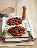Caramelised onion and beef pizzas