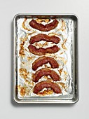 Roasted rashers of bacon on a baking tray lined with tin foil