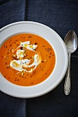 Pumpkin soup with crème fraîche and sesame seeds