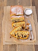 Fruit cake with icing sugar on a piece of baking paper