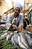 A fish seller at Luxor Souq, Egypt, North Africa