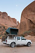 A car with a roof tent on the Grosse Spitzkoppe, Erongo Mountain region, Namibia