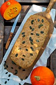 Pumpkin bread with pumpkin seeds on a chopping board