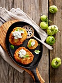 Fried, breaded green tomatoes in a pan
