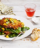 Corn fritters with mango salsa and rocket