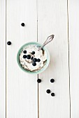 Vanilla yogurt with chia seeds and blueberries