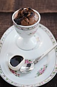 Baked chocolate pudding with chocolate sauce in an egg cup