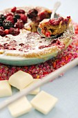 White chocolate bake with berries and icing sugar